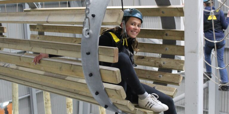 Relaxing on a High Ropes Obstacle at XC Hemel Hempstead